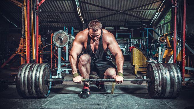 bodybuilder in gym about to deadlift