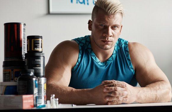 bodybuilder sitting down